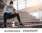 young man sitting at the stairs ... | Shutterstock . vector #590690099