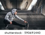 young man exercise in urban... | Shutterstock . vector #590691440
