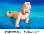 a cute smiling baby girl with... | Shutterstock . vector #590699174