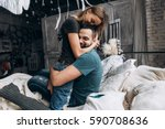 Stock photo  loving couple hug each other on the bed in big bedroom love story side view 590708636
