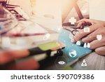 doctor working with laptop... | Shutterstock . vector #590709386