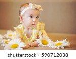 a cute baby girl in a lemon... | Shutterstock . vector #590712038