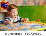 little boy play game | Shutterstock . vector #590724890