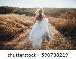 bride in wedding dress running... | Shutterstock . vector #590738219