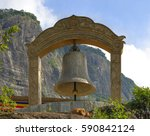 Small photo of Large bell covered with written, at the foot of the peak of Adam, Sri Lanka
