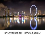 singapore city skyline at night ... | Shutterstock . vector #590851580