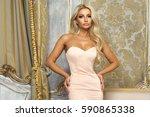 pretty elegant woman wearing... | Shutterstock . vector #590865338