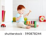 cute infant baby playing with... | Shutterstock . vector #590878244