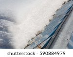 thawing of snow on a roof. snow ... | Shutterstock . vector #590884979