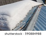 thawing of snow on a roof. snow ... | Shutterstock . vector #590884988