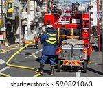 fire fighting by fire brigade   Shutterstock . vector #590891063