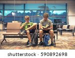 young man waiting for the plane ... | Shutterstock . vector #590892698