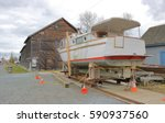 Small photo of A large private boat is positioned on blocks to allow for full scale restoration/Setting Up for Boat Repair/A large private boat is positioned on blocks to allow for full scale restoration.