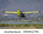 Ultralight Aircraft Flying Ove...