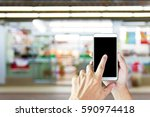 man use mobile phone  blur... | Shutterstock . vector #590974418