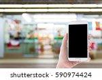 man use mobile phone  blur... | Shutterstock . vector #590974424