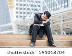 asia businessman sleeping at... | Shutterstock . vector #591018704