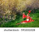 kazakh woman in red costume... | Shutterstock . vector #591031028
