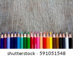 color pencil row on the wooden... | Shutterstock . vector #591051548