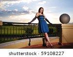 Lady On Balcony
