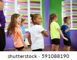 children dancing in... | Shutterstock . vector #591088190