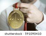 man holding a golden award... | Shutterstock . vector #591090410