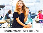 young pretty woman drinking... | Shutterstock . vector #591101273