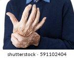 close up of senior man... | Shutterstock . vector #591102404