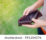 Small photo of Unhappy bankrupt woman with empty wallet. Young woman shows her empty wallet. Bankruptcy