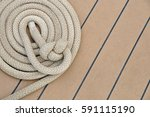 rolled up rope on boat deck | Shutterstock . vector #591115190