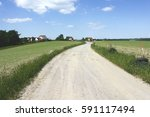 rural road fields and blue sky | Shutterstock . vector #591117494