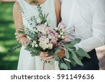 bride and groom in a light... | Shutterstock . vector #591149636