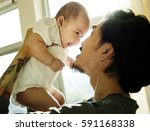 daddy and baby playing... | Shutterstock . vector #591168338