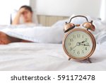 clock background man lying on... | Shutterstock . vector #591172478