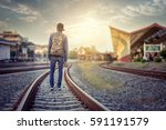 man walk away on railroad with... | Shutterstock . vector #591191579