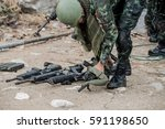 Gun Of A Soldier On The Ground...