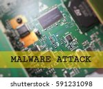 Small photo of Cyber security concept. Computer electronic board circuit with word malware attack