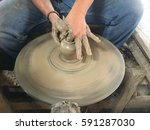 making a clay pottery | Shutterstock . vector #591287030