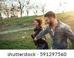 portrait of a happy couple... | Shutterstock . vector #591297560