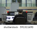 a security man controls the... | Shutterstock . vector #591311690