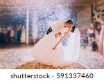 first wedding dance of newlywed | Shutterstock . vector #591337460