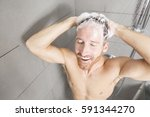 a man in shower washing his... | Shutterstock . vector #591344270