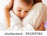 Dreamy Little Boy Hugs His...
