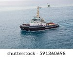 A Large Tugboat Sailing Throug...
