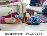 closeup seamstress on the... | Shutterstock . vector #591371693
