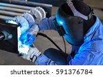 welder working a welding metal  ... | Shutterstock . vector #591376784