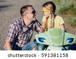 father and daughter playing on... | Shutterstock . vector #591381158