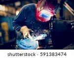 welding steel with sparks using ... | Shutterstock . vector #591383474