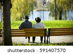 elderly man and woman in the... | Shutterstock . vector #591407570