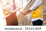 engineers shaking hands at... | Shutterstock . vector #591411839